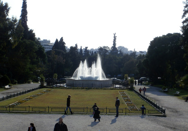 The water fountains at Zappeion Gardens, against the sun, on a December early afternoon.
