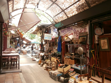 Antique stores line up Avissynias Square within Monastiraki.