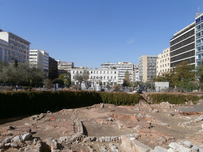 Kotzia Square. The archaeological site looking towards the City Hall.