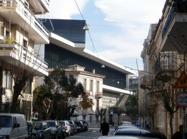 The back of the Acropolis Museum among local buildings.