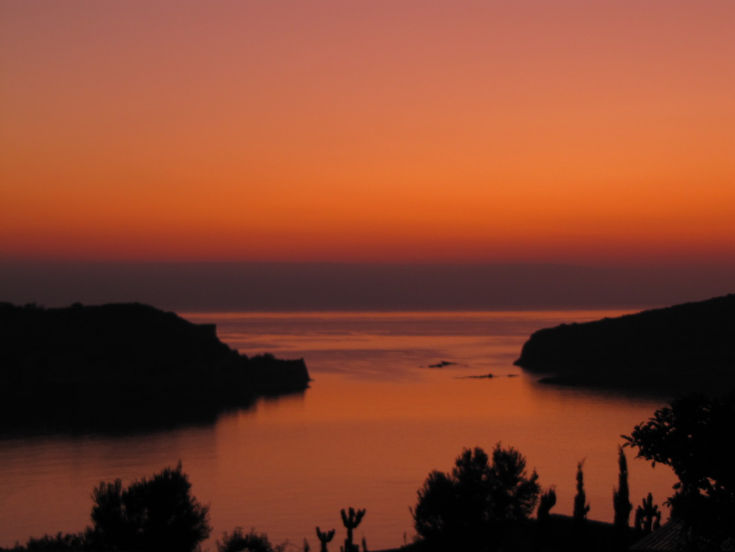 """Sunrise off Elunda - Crete"" by seligmanwaite is licensed under CC BY 2.0"