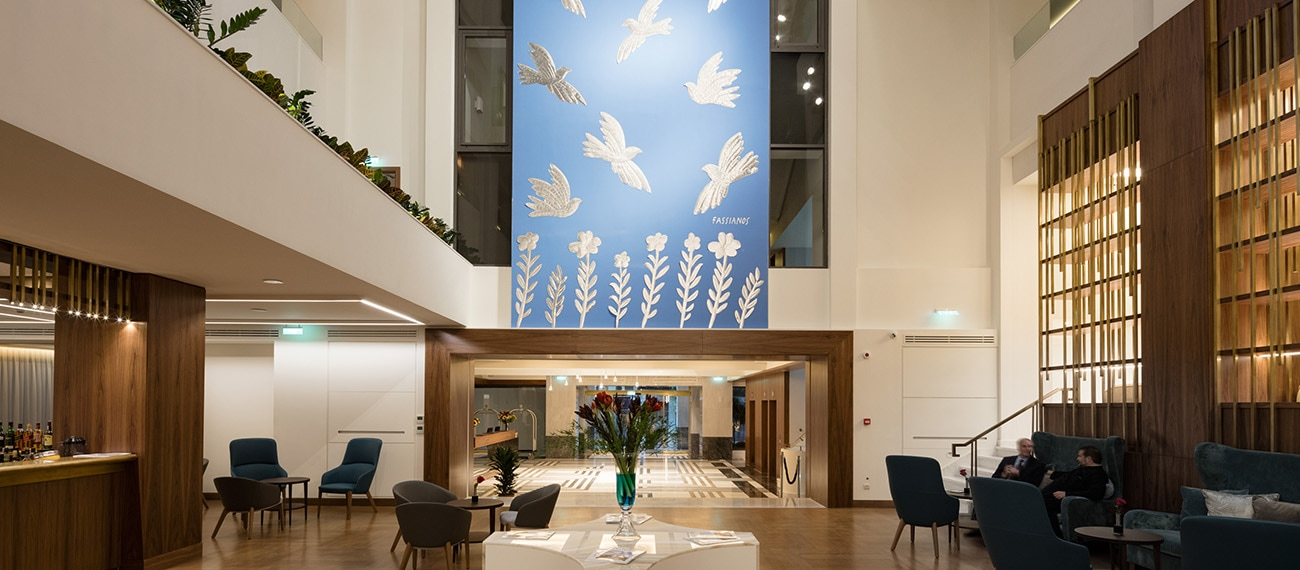 The Atrium lounge of the Electra Metropolis Hotel in Athens. Centerpiece painting by Alecos Fassianos.