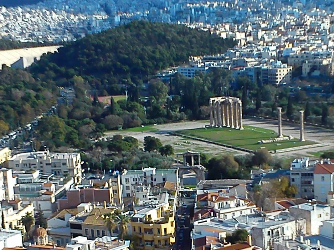 The Temple of Olympian Zeus as seen from the Acropolis. At the forefront, Hadrian's Arch, and at the far back left the Panathenaic Olympic Stadium. Photo courtesy Sophia Yiannakou.