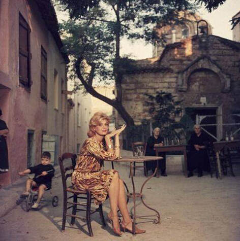 Actress Melina Merkouri, posing in front of Agios Ioannis Theologos church in a 1960 photograph.
