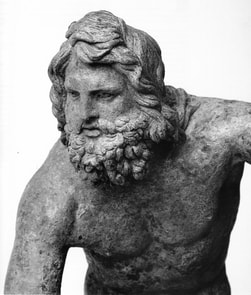 Head of Poseidon, from a bronze statuette at the National Archaeological Museum.