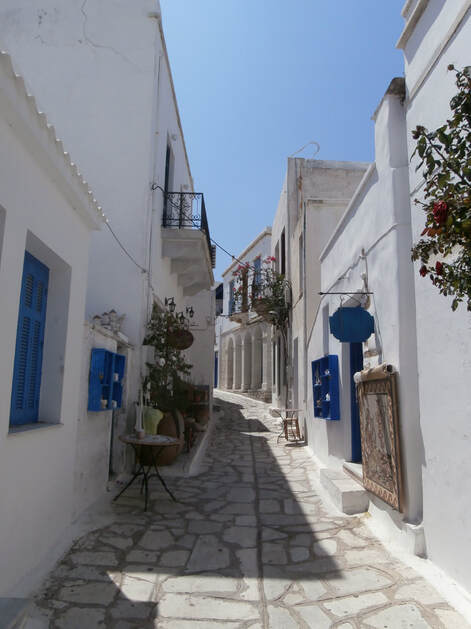 A picturesque narrow street on the island of Tinos.